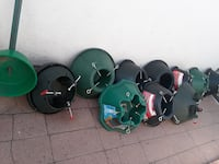 green and black Christmas tree stand lot