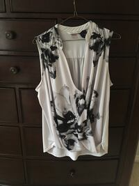 Sleeveless white summer top with floral print