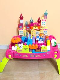 pink, yellow, and purple castle toy Houston, 77083