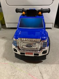 Ford ride on truck with under seat compartment.