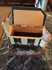 Brown and white wooden house miniature music box Houston, 77022
