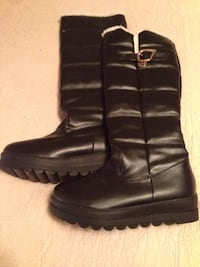 pair of black leather boots Mont-Royal, H3P 1Z4