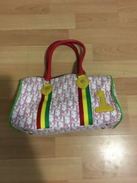 Red, yellow, and green leather handbag