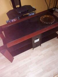 brown and black wooden TV stand Saint-Philippe, J0L 2K0