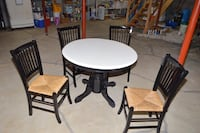 round white wooden table with four chairs null
