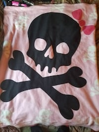 black and pink skull print textile