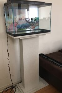 Fish tank with marble stand.