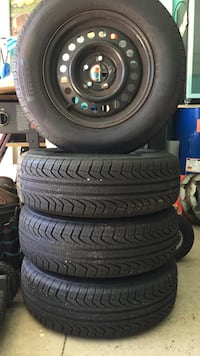 Black 5-spoke auto wheel with tire set brand new they fit on any chevy car pirelli tires and rims P195/70R14. Elkhart, 46514