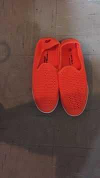 pair of red rubber clogs New York, 10454