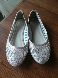 pair of gray embellished slip-on shoes