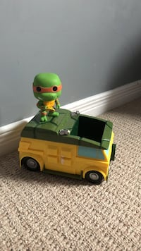yellow and green plastic car toy and TMNT Michaelangelo action figure