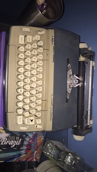 Electric Smith-Corona Type Writer with Ink-Wheels.