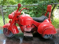 red and black motorcycle ride-on toy