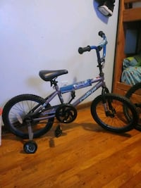 toddler's blue and black bicycle with training wheels Bronx, 10457