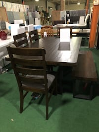 Brand new 6 piece dining set. Table and 4 chairs and a bench  Wellington, 33449