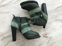 pair of black-and-gray leather booties New York, 11201