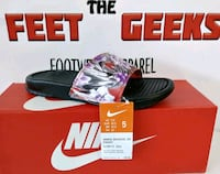 GIRLS NIKE SLIDES SANDALS SIZE 5Y OR SIZE 7 WOMENS Cleveland, 44102