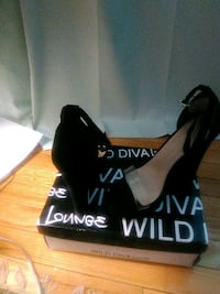 pair of black suede peep-toe wedge heels. Size 7 Montgomery Village, 20886