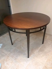 round brown metal table with black metal base Atwater, 95301