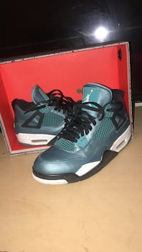 pair of teal-and-green Air Jordan basketball shoes with box