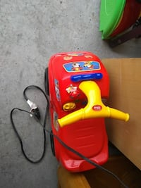toddler's red and yellow Disney ride-on toy car