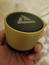 round black and yellow portable speaker
