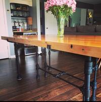 6 foot table. Custom built. The top is made out the wood used in bowling Alley. Similar tables go for 2k or more on Etsy. Bloomington