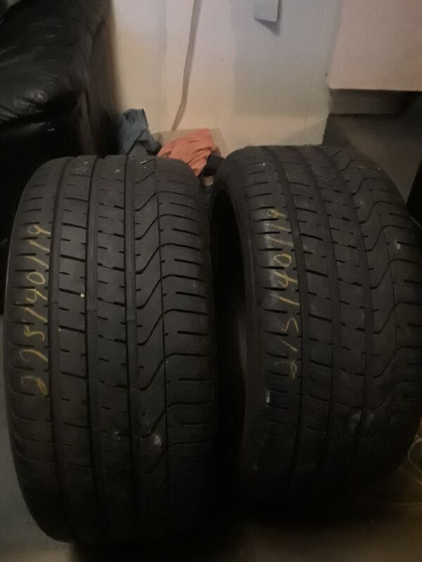 two 225/140R19 vehicle tires
