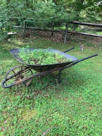 Antique iron wheel barrow. Looks great with flowers but the deer keep eating mine! Ringwood, 07456
