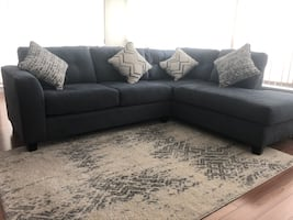 Sectional sofa, 4 pillows and rug