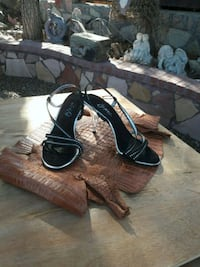 pair of black open-toe ankle strap heels 1691 mi