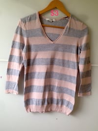 gray and white striped v-neck sweater