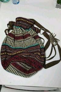 black, red, and white tribal print backpack 44 km