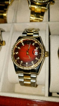 round gold Rolex analog watch with link bracelet Brampton, L6T 4A2