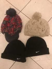 tow black, one red, and white knit caps