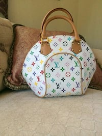 white and brown Louis Vuitton leather tote bag