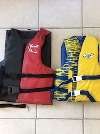 Life vests - yellow is size 50-90 pounds. Red is Adult, more than 90 pounds  422 mi