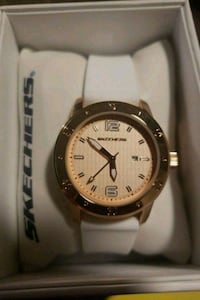 round silver-colored analog watch with white leather strap London, N5V 3Y4