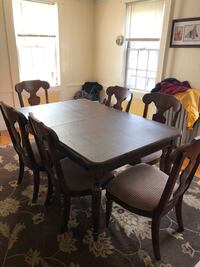 Dining room set with table, six chairs and hutch. Table comes with extender and padding Bristol, 02809