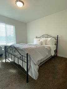 Queen bed Including frame, mattress, and box spring.