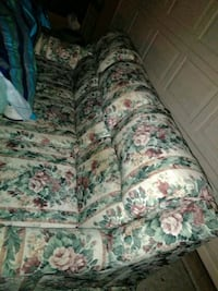 white, green, and pink floral fabric sofa