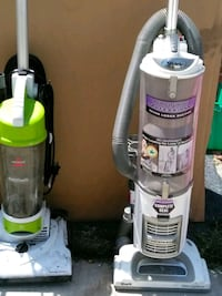 two gray and purple upright vacuum cleaners San Diego, 92102
