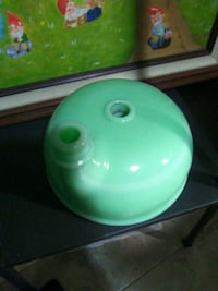 green and white plastic container