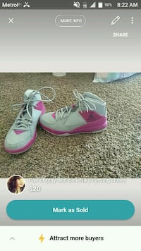 pair of gray-and-pink Nike running shoes El Paso, 79924