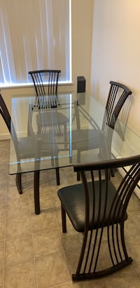 Rectangular glass top table with four chairs dining set Tigard, 97223
