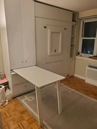 Murphy Bed with tons of storage and TWO fold down tables for sale!