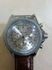round silver chronograph watch with black leather strap Barrie, L4M 2W3