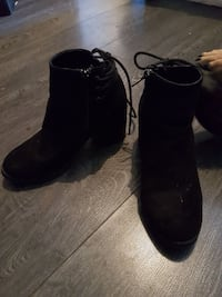 pair of black leather boots Winnipeg, R2W 2E7
