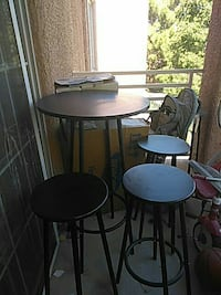 round brown wooden table with three stools North Las Vegas, 89031
