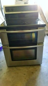 Electric silver and black induction range oven